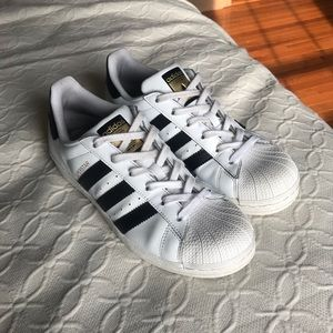 ADIDAS Superstars with gold tongue